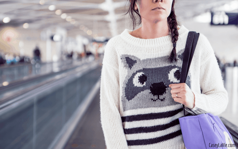 Tips and tricks for surviving a long airplane flight, including a carry on packing list and travel tips.